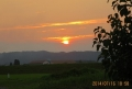雲の嶺に日が沈む
