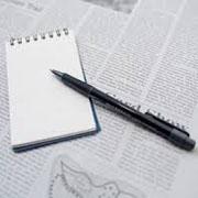 書類を書く紙とペン